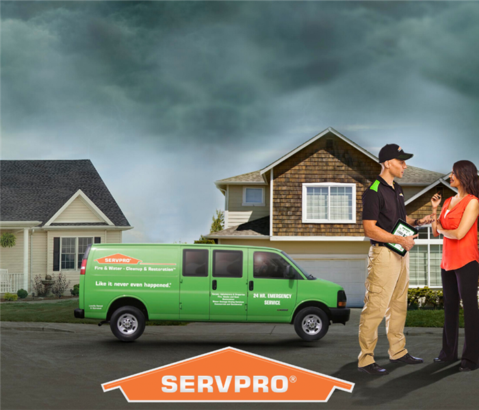 A SERVPRO Technician meets with a resident to inspect damage.